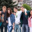Teenage group embracing — Stock Photo