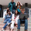 Group of male and female students against the background an acad — Stock Photo