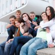 Group of male and female students against the background an acad — Stock Photo #9523043