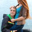 Portrait happy young teenage couple outdoor — Stock Photo #9523094
