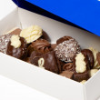 Assorted chocolate pralines in a box - Stock Photo