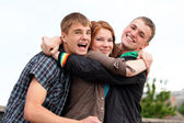 Portrait of three young teenagers — Stock Photo