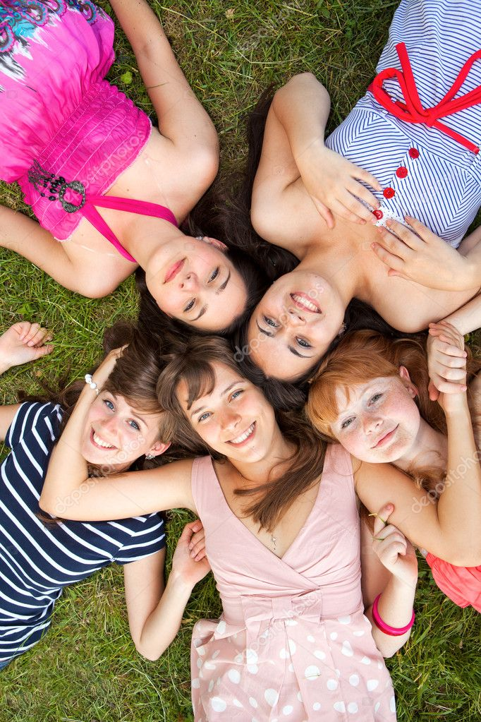 Group of girls teenagers in park on grass  Stock Photo #9521626