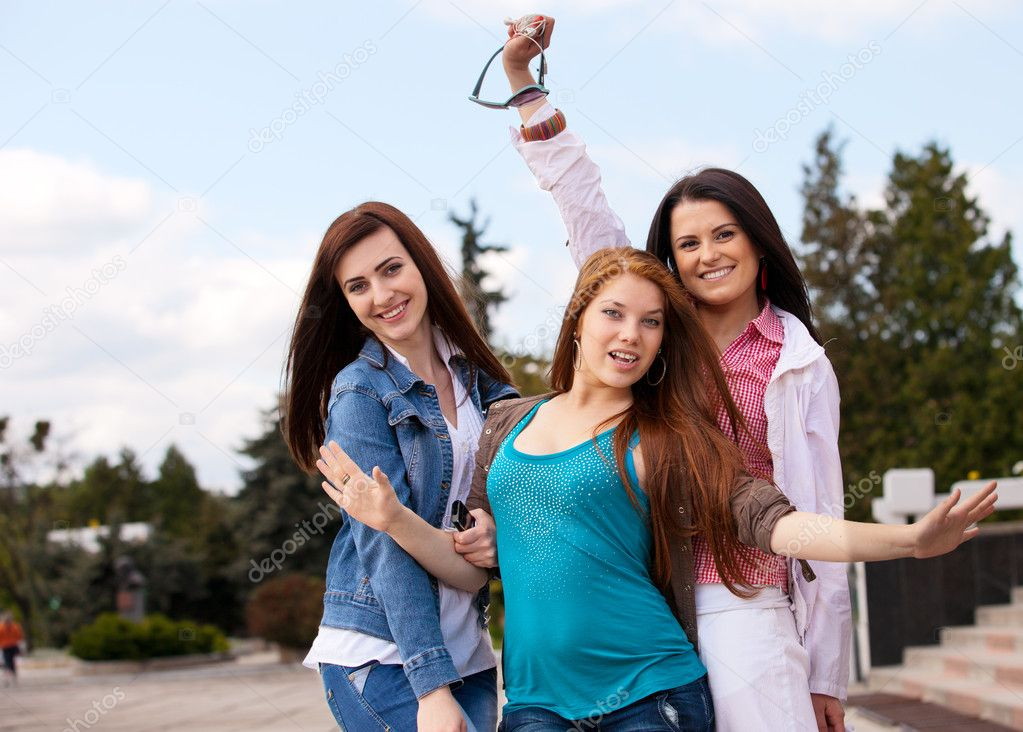 Portrait happy young and attractive girlfriends — Stock Photo #9522788