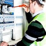 Electrician checking a fuse box — Stock Photo #9141111