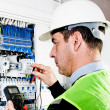 Electrician checking a fuse box — Stock Photo #9141190