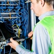 Engineer in network server room solving problems — Stock Photo