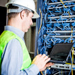 Engineer in network server room solving problems — Stock Photo #9141271