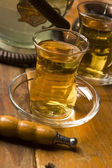 Cup of turkish tea and hookah served in traditional style — ストック写真
