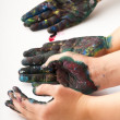 Kids hands covered with paint - Stock Photo