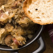 Traditional polish sauerkraut (bigos) with mushrooms and plums f — Stock Photo