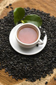A cup of green tea with freh leaves — Stock Photo