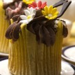 Spring muffins decorated with flower petals with tulips - Stock Photo
