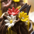 Spring muffins decorated with flower petals with tulips — Stock Photo #9942403