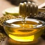Fresh honey and bee pollen — Stock Photo