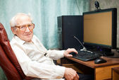 Pleased Old Man Near Computer — Stock Photo