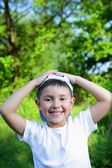 Smiling boy in blue hat — Stock Photo