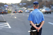 A policeman in uniform on the road — Stock Photo