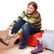 Woman trying on new boots — Stock Photo