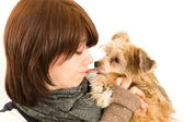 Beautiful young girl kissing the dog — Stock Photo