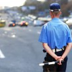 Policeman waits to catch speeding drivers — Stock Photo