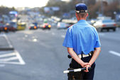 Policeman waits to catch speeding drivers — Stockfoto