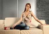 Woman on sofa — Stock Photo