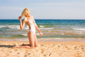 Beautiful slim blonde kneeling — Stock Photo