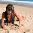 Girl lying on the beach — Stock Photo #10055507