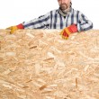 Carpenter and plywood — Stock Photo