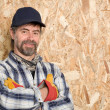 Smiling carpenter in a cap — Stock Photo