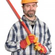 Smiling builder holds level - Stock Photo