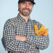 Cheerful man in cap - Stock Photo