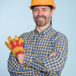 Cheerful man in helmet - Stock Photo