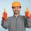 Happy smiling builder - Stock Photo
