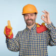 Happy builder with thumbs up gesture - Stock Photo