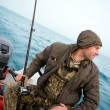 Fisherman fishing a salmon trolling — Stock Photo