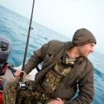 Fisherman fishing a salmon trolling — Stock Photo