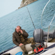 Fisherman was talking on his mobile — Stock Photo