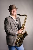 Smiling young man with a saxophone. — Stock Photo