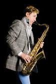Mens de saxofoon spelen — Stockfoto
