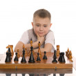 Little boy plays chess — Stock Photo
