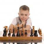 Little boy plays chess — Stock Photo
