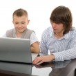 Elder and younger brothers for a laptop — Stock Photo