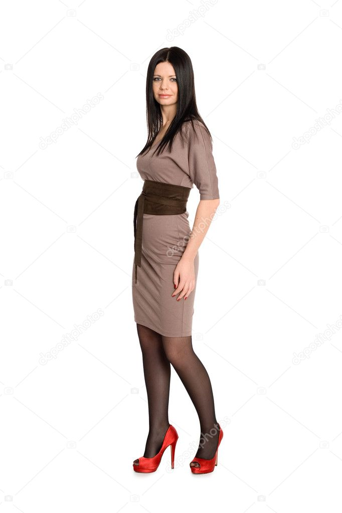 Beautiful slim girl in a brown dress and high heels. — Stock Photo #8891348
