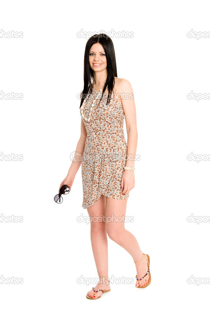 Beautiful young brunette in a summer dress — Stock Photo #8936678