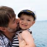 Father kisses his son — Stock Photo #9231670