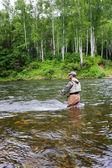 Pescador de capturas de salmão — Foto Stock