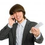 Businessman talking on mobile emotionally — Stock Photo