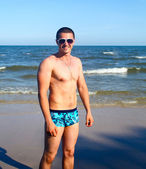 Man in swimming trunks — Stock Photo
